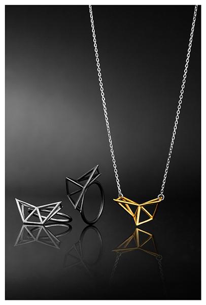 Still life of Icelandic jewelry on a black plexiglass