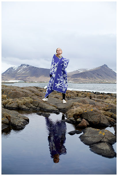 Katrin Berndt wearing an Alrun blanket in Akranes