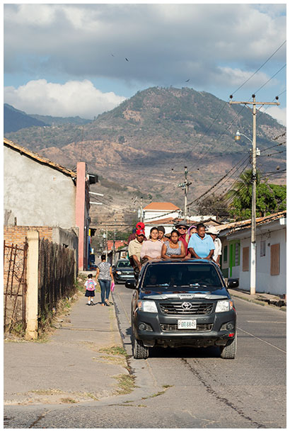 Coffee farmers going to work in a pick up truck in Honduras