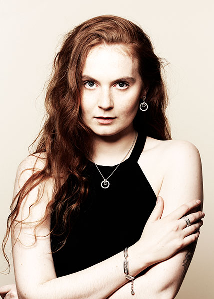 Red haired model with jewelry